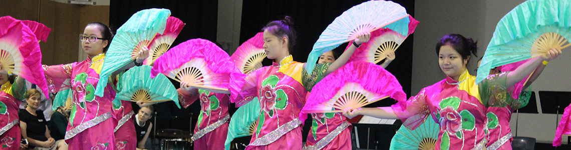 international students dancing in traditional Chinese costume